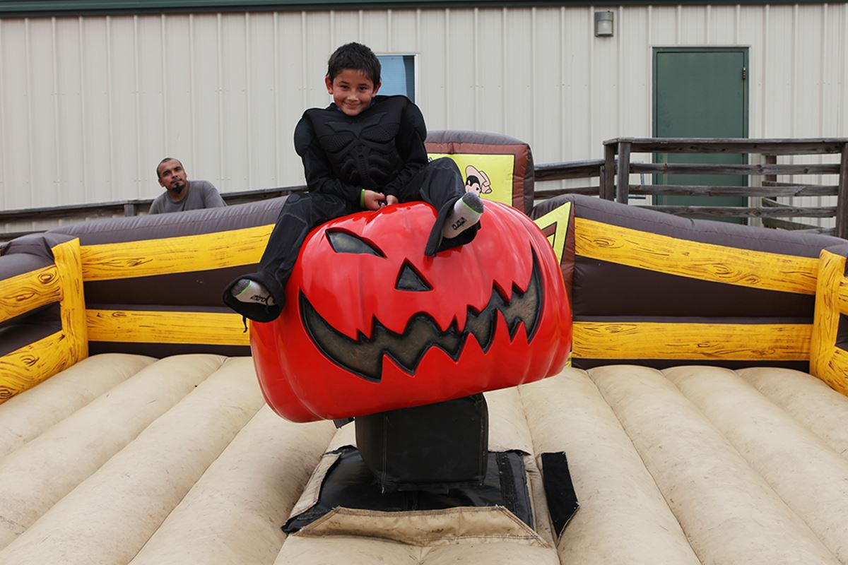 PumpkinFest_boy riding pumpkin