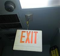 Exit sign by wires