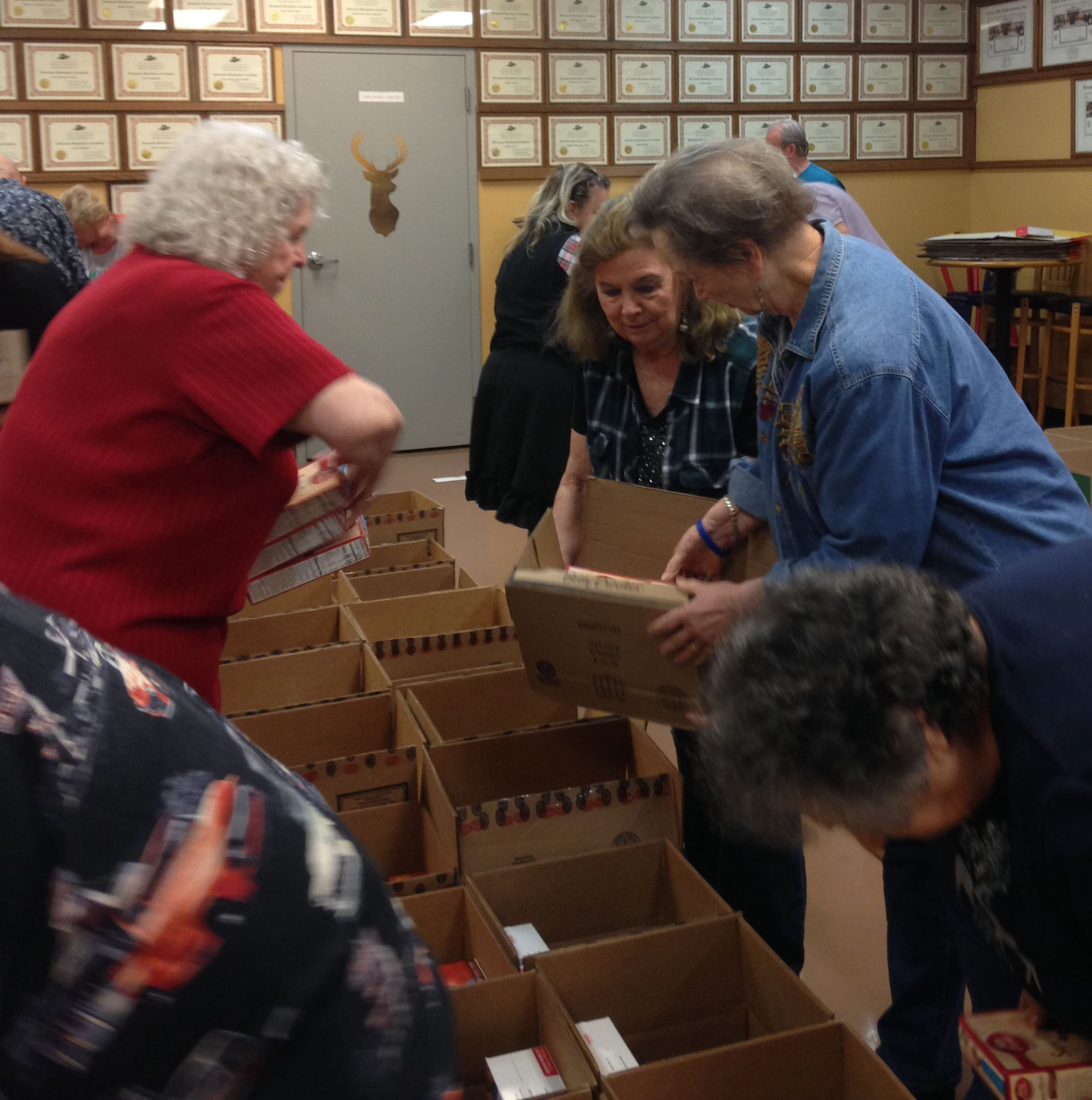Mesquite Elks Lodge Auxiliary ladies pack boxes of food