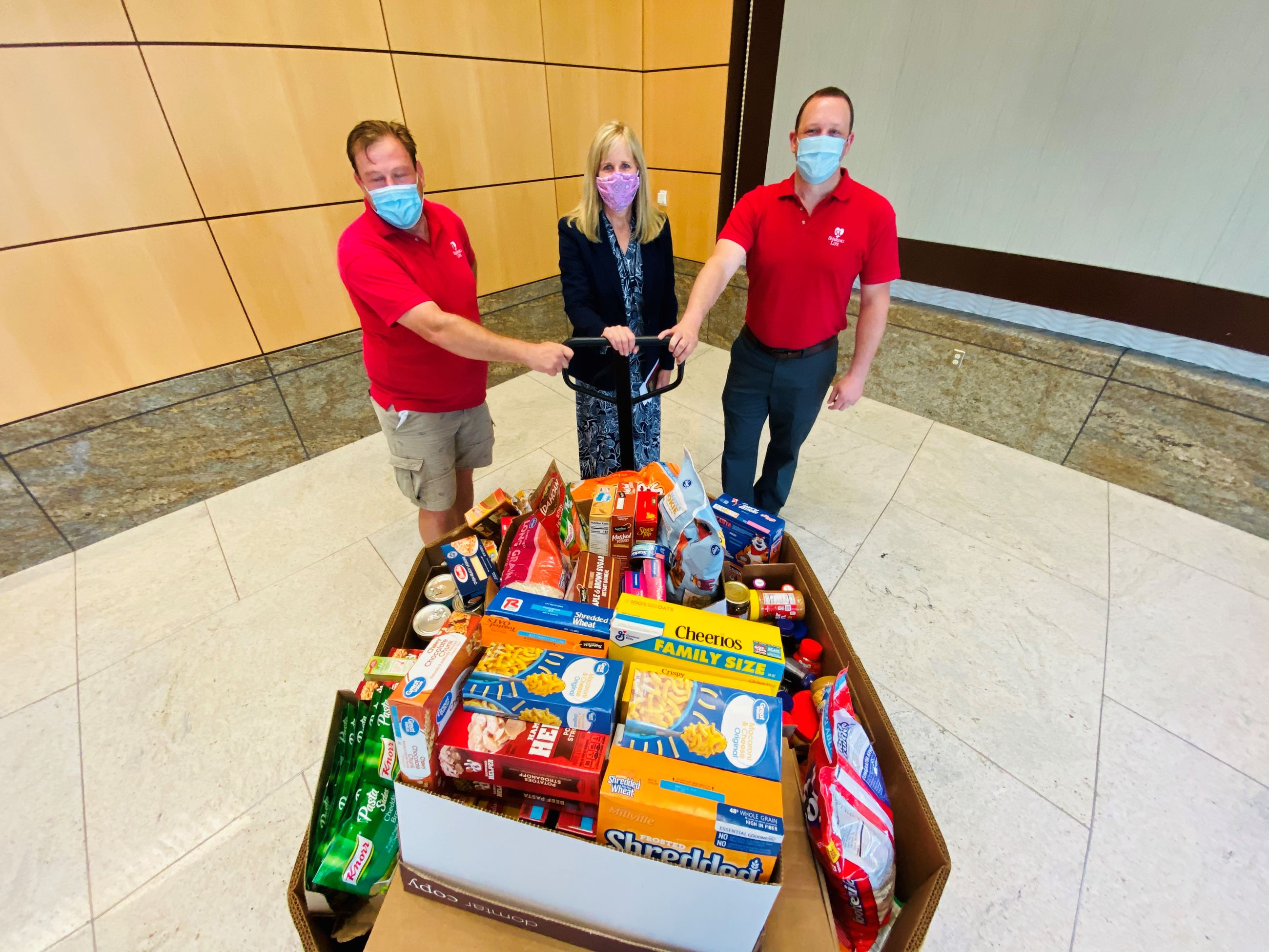 6-29-20 Mesquite Dir of Finance Debbie Mol presents food donations to  local food pantries