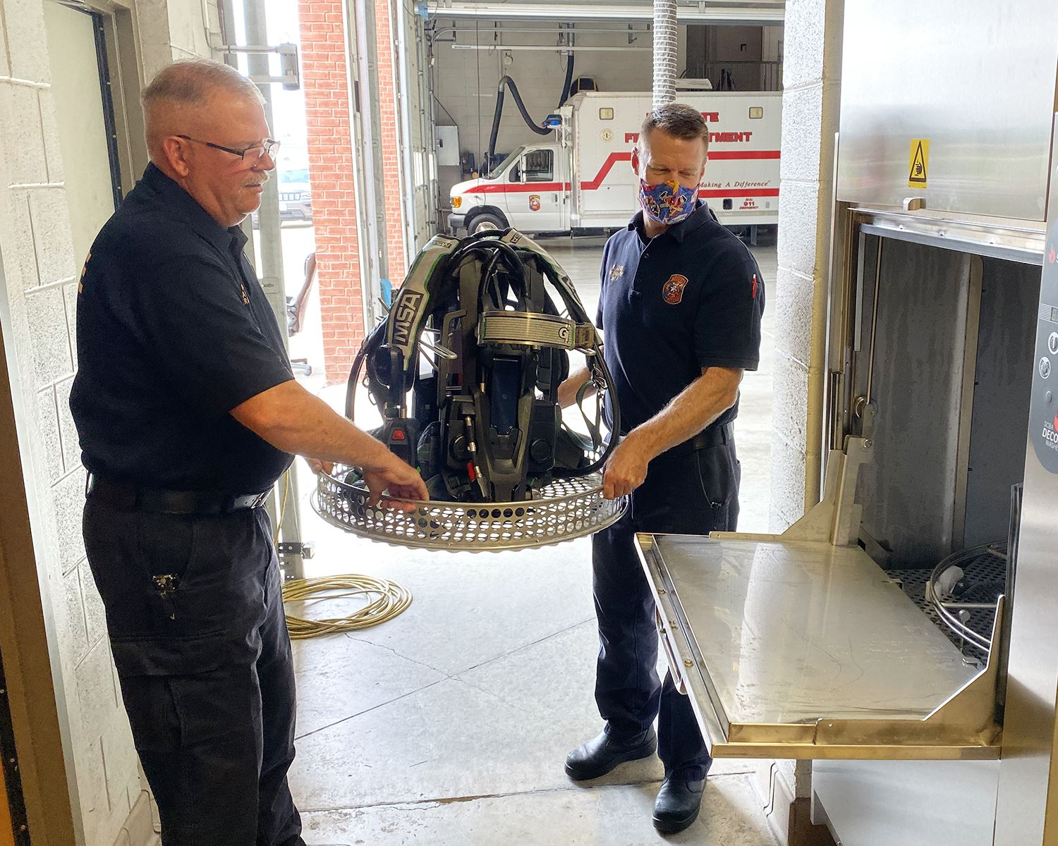 Mesquite Fire - placing SCBA in washer 2