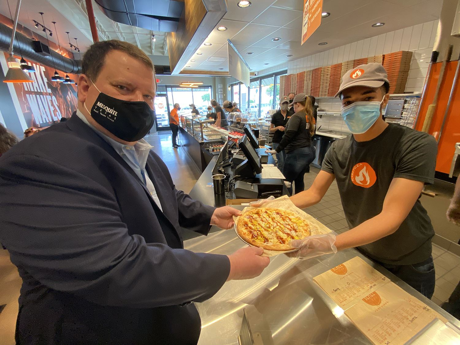 5-4-21 Baze employee serves mayor his pizza